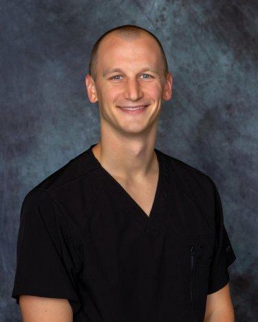 Dr. Adam Beswick
